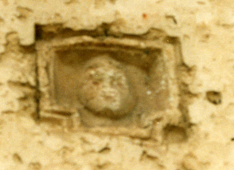 Carved face in Cabrales